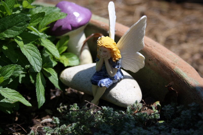 The newest addition to my fairy garden - she is deep in thought.
