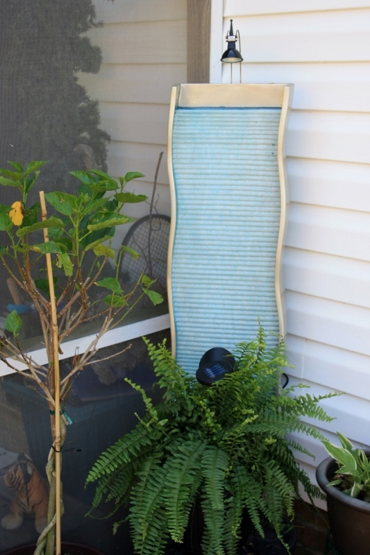 One of my favorite corners of the porch. The fountain has blue food coloring to deepen the color.