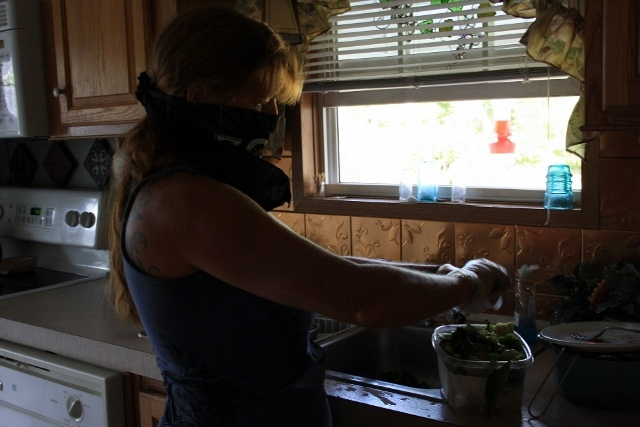 Mom is coring the jalapenos and green bell peppers for storage in the freezer - the jalapeno fumes really got to her this time.