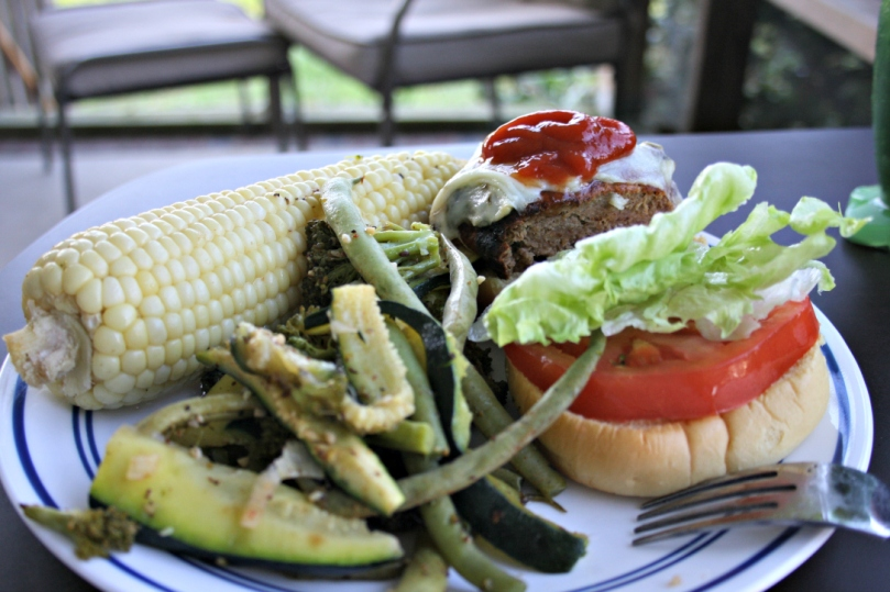 Monday night's dinner - deer burger with sweet corn and vegetables from the boyfriend's garden.