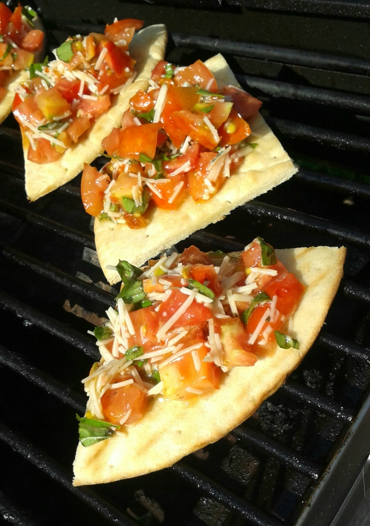 Another thing my mom likes to do with tomatoes is to top pizza crust with homemade bruschetta and grill it.